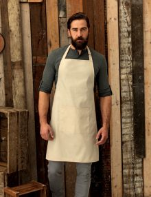Waiter wearing bib apron with pocket