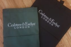 Green and Black Aprons with Embroidered Logos