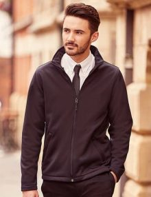 Man wearing black softshell jacket