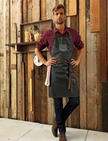Waiter wearing black denim apron